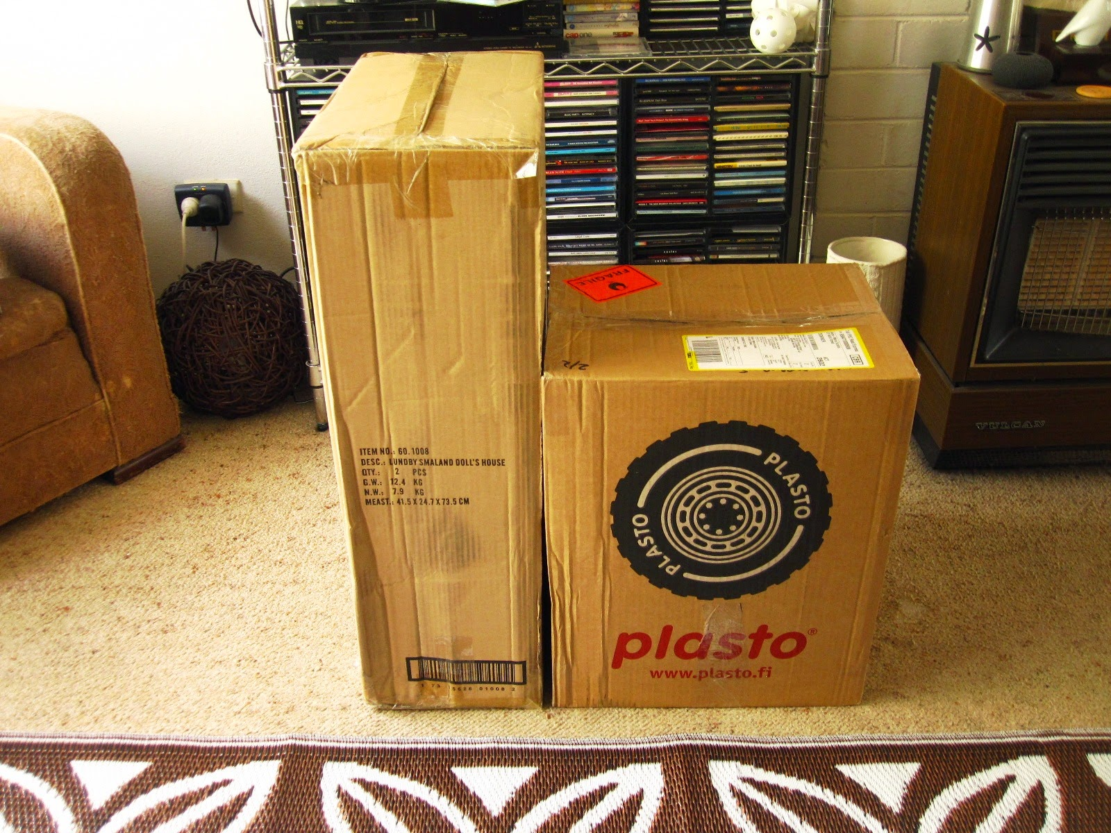 Two large shipping cartons sitting on a living room floor.