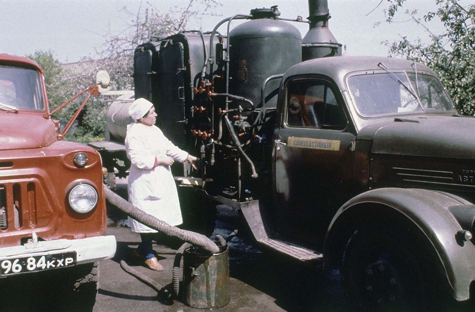 A Soviet technician prepares a tank truck with a solution designed to decontaminate people's clothes and equipment in Kiev on May 9, 1986.