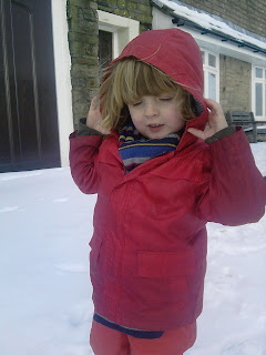 Toddler in the snow.