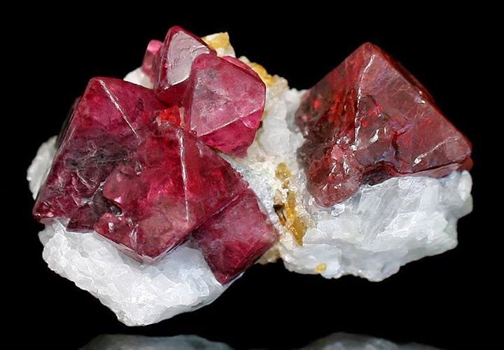 Deep Red Crystals Of Spinel Set Atop White Marble Matrix