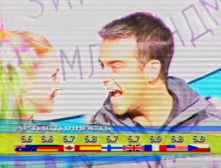 videos-musicales-de-los-90-robbie-williams-she-is-the-one