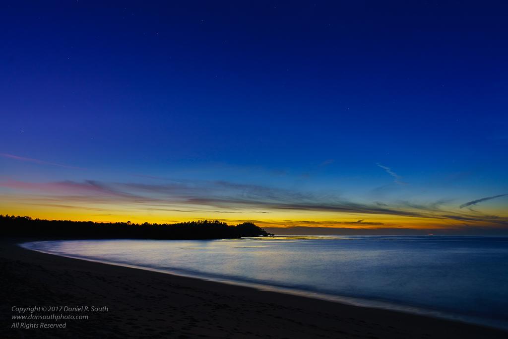 a photo of a sunset over point lobos near carmel california