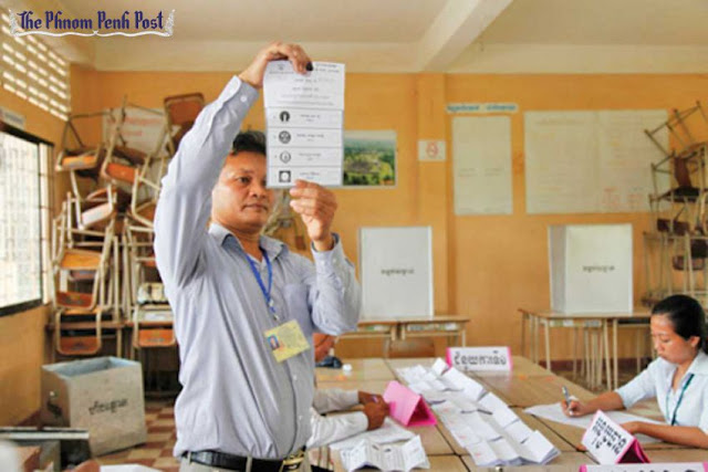 Officials tally votes following the 2012 commune elections. Heng Chivoan