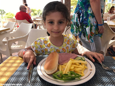 Child eating at holiday buffet in Fuerteventura