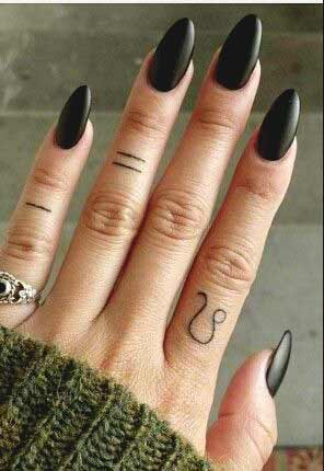 Tiny Leo zodiac sign tattoo design on index finger