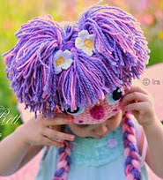 http://www.ravelry.com/patterns/library/yarn-hair-tutorial---free-pdf