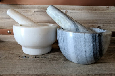 Marble and granite mortar and pestle sets.