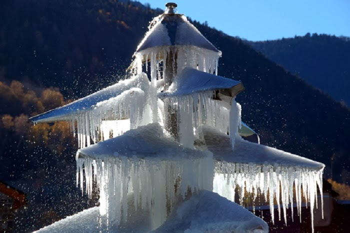 Saint-Lary, France - Winter Blast Transforms Water Fountains Into Magical Ice Sculptures