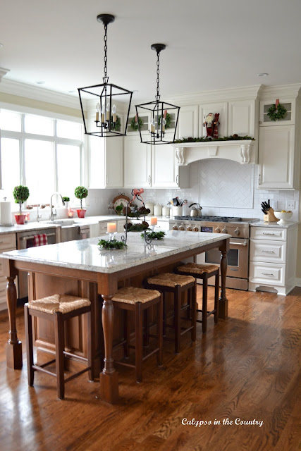 White Kitchen decorated with red and green for Christmas