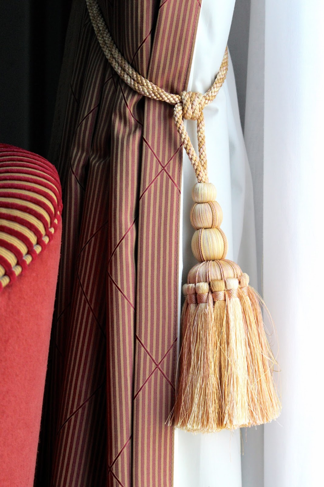 Large golden curtain tassel at hotel