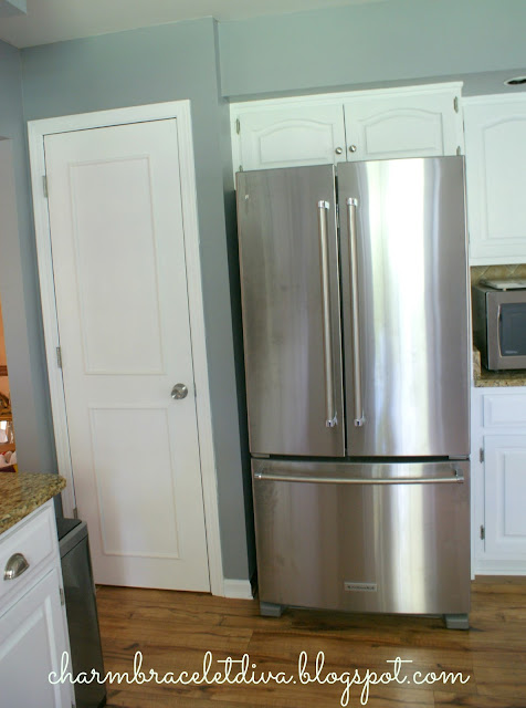 white farmhouse kitchen stainless steel French door refrigerator