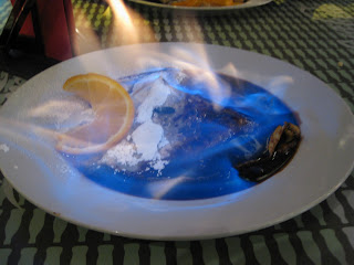 Rum-walnut and chocolate crepe served flambéed