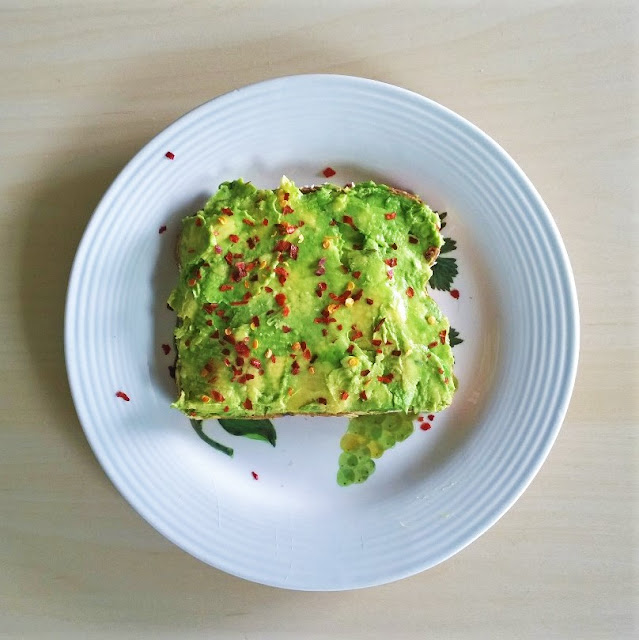 Avocado Toast with Siracha, tomato, and red pepper flakes