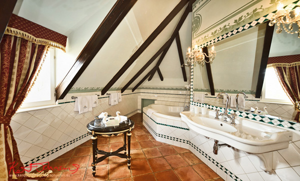 A grand bathroom in an attic room. Boutique Hotel photography in Prague by Kent Johnson.
