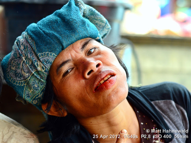 people, Batak woman, street portrait, Indonesia, Sumatra, Lake Toba, betel nut, betel quid, areca nut, sirih, paan, chewing tobacco, red coloured salivation, red stained teeth