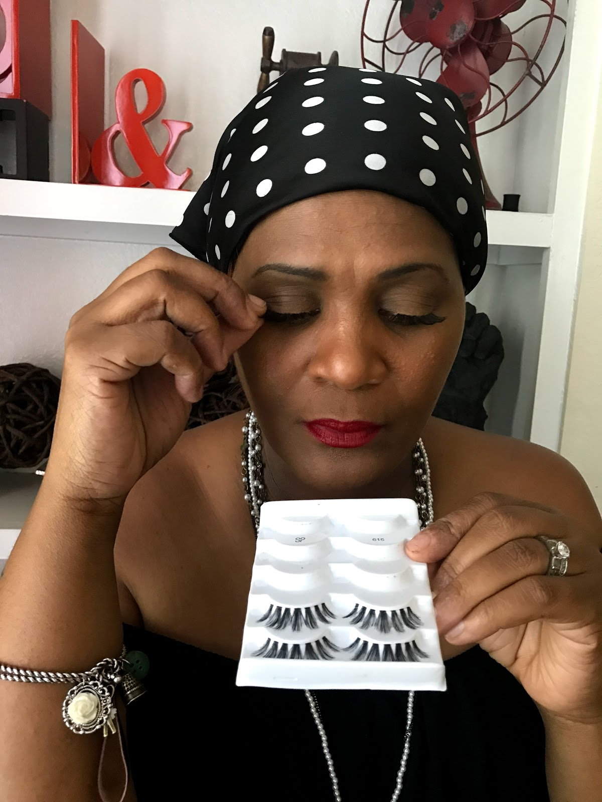 Image: Woman removing eyelashes before removing makeup. Forty-something blogger