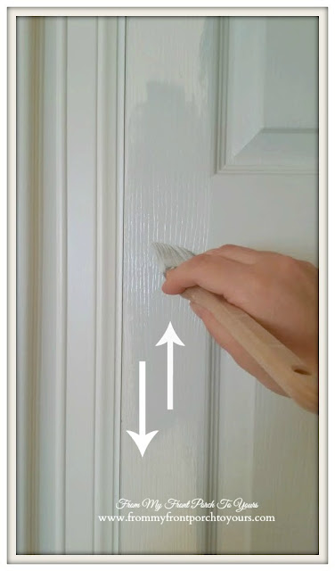 Tip to have next to no brush marks while painting door is to use long brush strokes following the wood grain pattern-From My Front Porch To Yours.