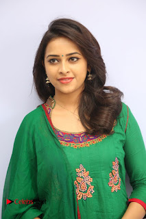 Actress Sri Divya Pictures in Green Salwar Kameez at Rayudu Team Meet  0019.JPG