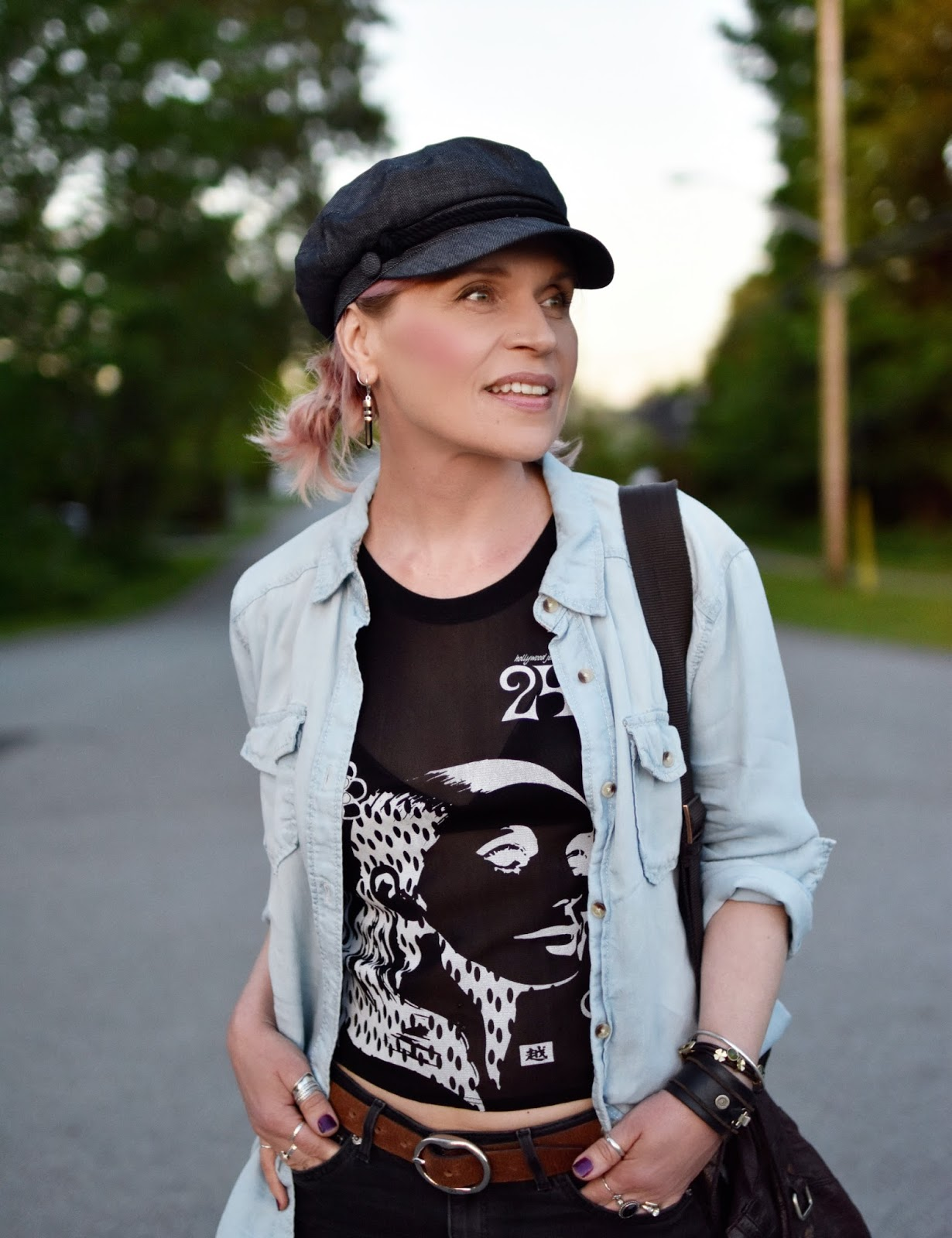 Monika Faulkner outfit inspiration - graphic top, chambray shirt, baker boy cap
