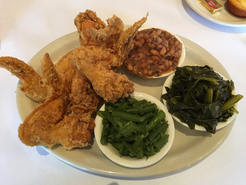 Fried chicken wings, green beans, black eyed peas, and collard greens at Souls Restaurant