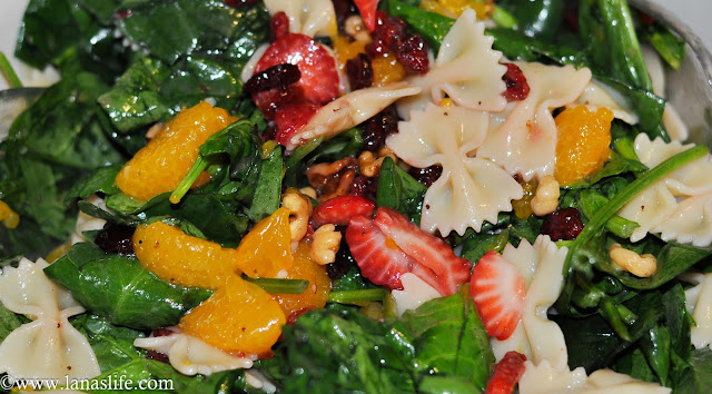 After a big holiday celebration, I bet a lot of you are filing away recipes of your favorite foods. Before you put those all away, I have one more to add to your pile.  This Spinach Pasta Salad with Mandarin Oranges and Strawberries is going to be a salad you'll be making several more times this summer and throughout the rest of the year.  It's light, sweet, tangy, and it can stand on its own as a meal if you add some chicken or tuna to this fruity, nutty salad.
