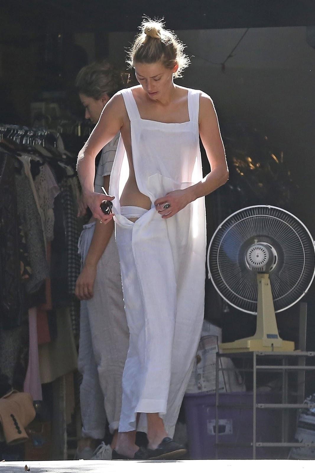 Amber Heard Topless Pics amber heard suffers wardrobe malfunction in la