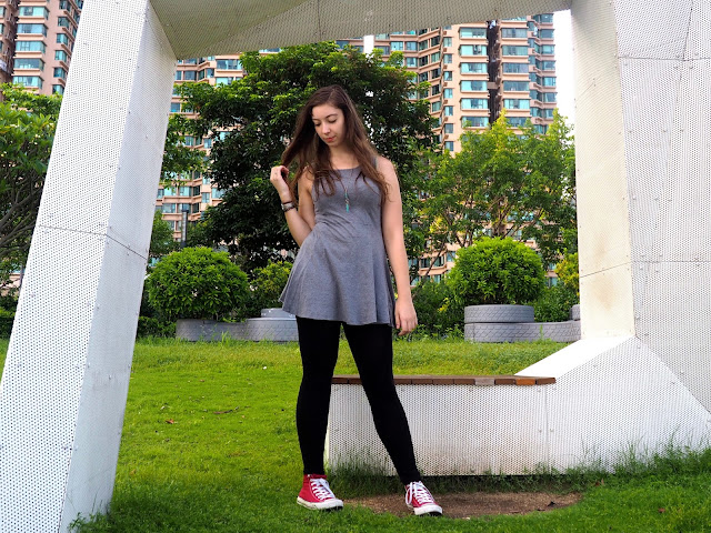 On The Move | outfit of short grey skater dress, black leggings, and red high top Converse