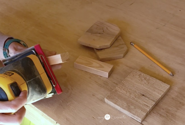 sanding wood to make a small gift crate