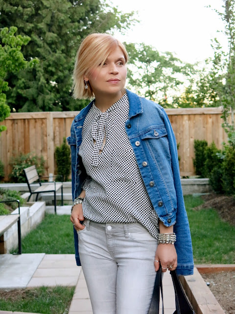 grey skinny jeans, bow-front blouse, denim jacket