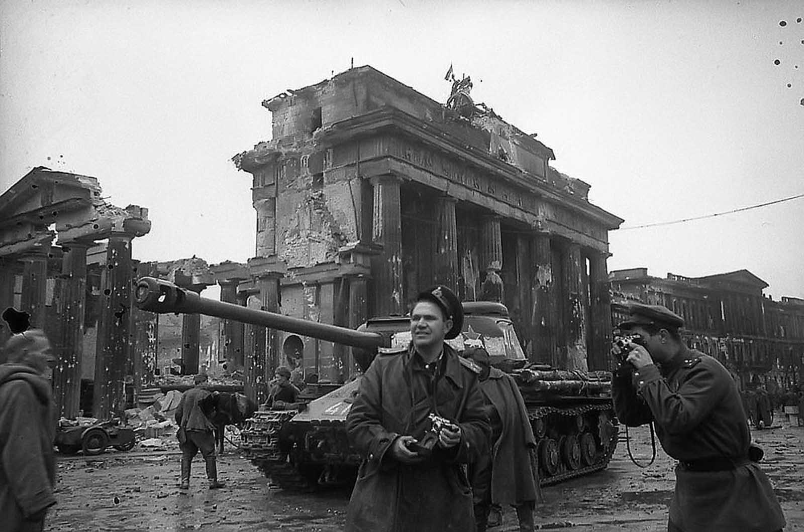 Red Army photographer Yevgeny Khaldei (center) in Berlin with Soviet forces, near the Brandenburg Gate in May of 1945.