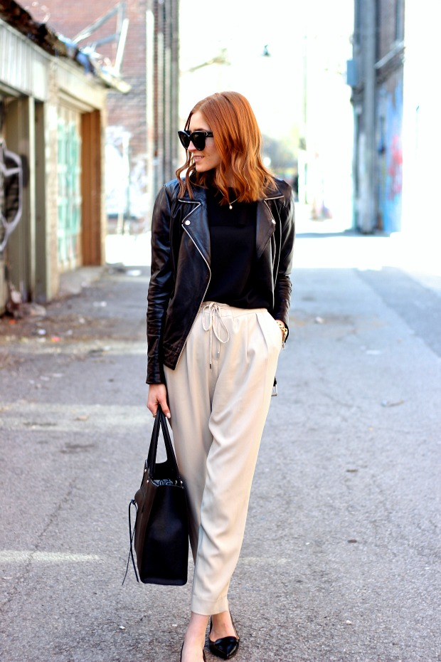 Spring city street style- Banana Republic ruffled black blouse and Zara beige trousers, pointy toe flats, Rebecca Minkoff bag, Celine Caty sunglasses