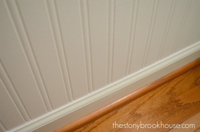 caulking along the baseboard