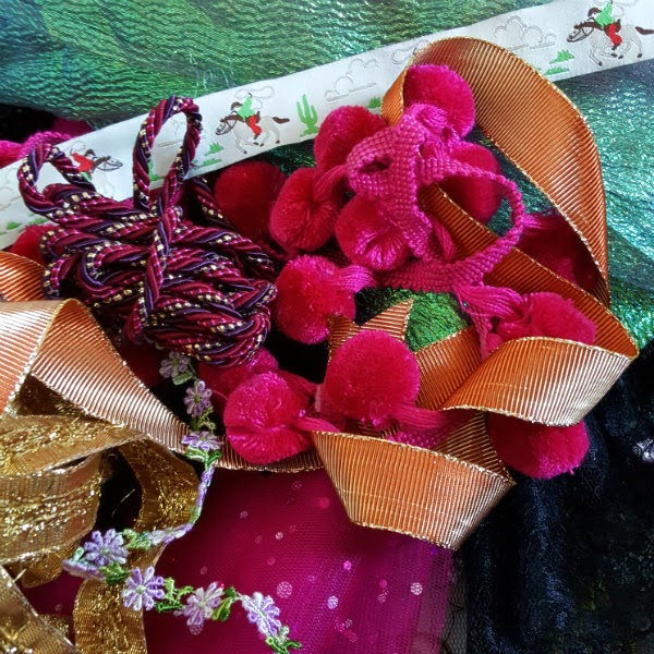 pom poms, ribbons, lace, cord and fabric materials for sewing