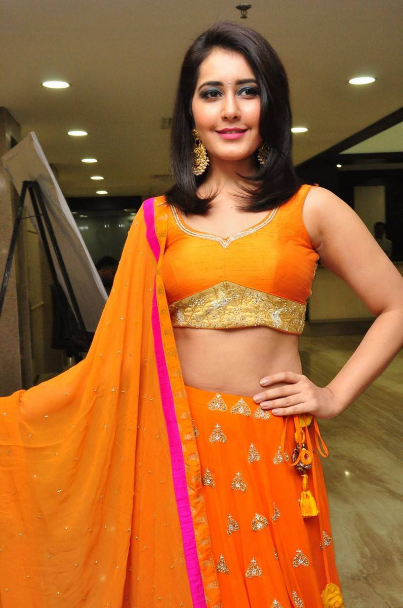 Rashi Khanna Latest Hot Stills In Orange Dress
