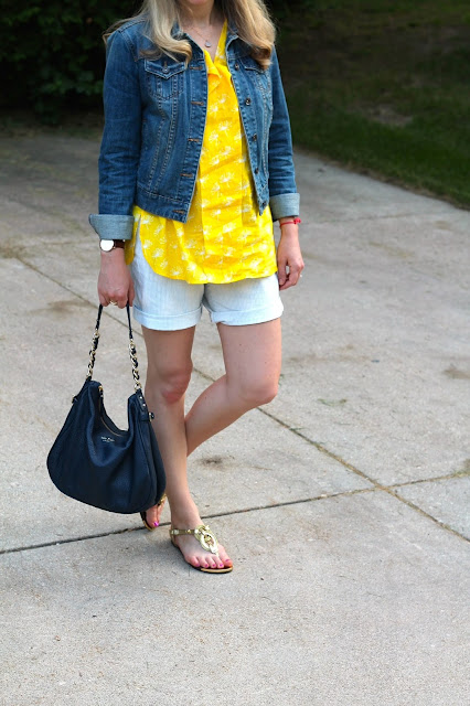 eshakti yellow tunic top, jean jacket, pinstripe shorts, gold sandals, blue kate spade bag