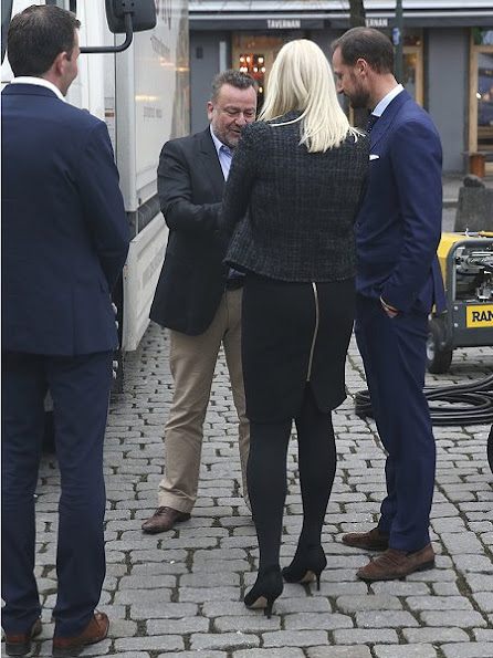 Crown Princess Mette-Marit wore Prada blazer, coat, Prada skirtsuit, Prada pumps and Prada clutch bag