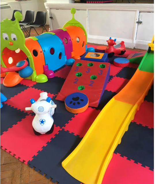 image shows a selection of soft play equipment set up for a party