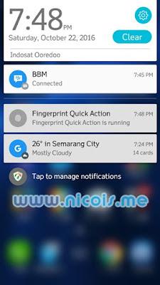 Membuka panel notifikasi dengan gestur swipe fingerprint scanner