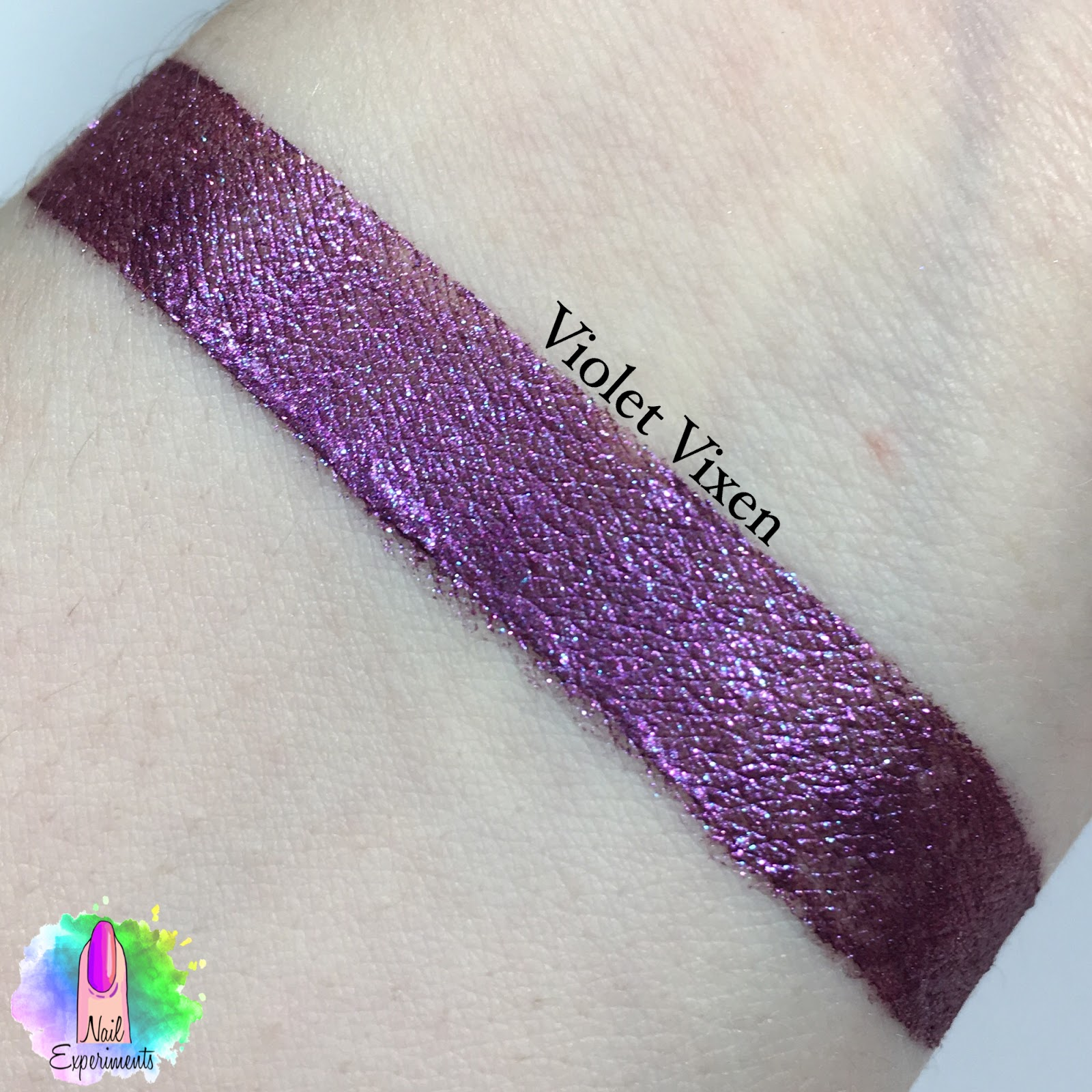 Stila magnificent metals glitter and glow liquid eye shadow swatch in violet vixen