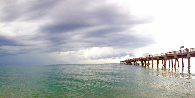 clouds over the ocean at Juno Pier