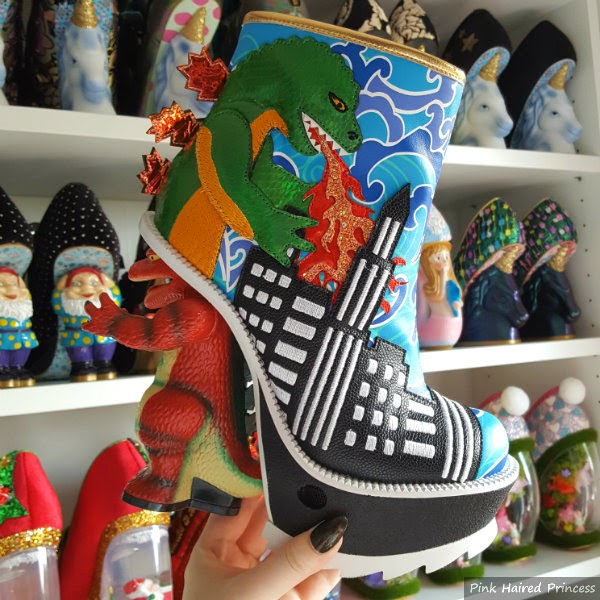 dinosaur themed ankle boot and heel in hand in front of shoe room shelves