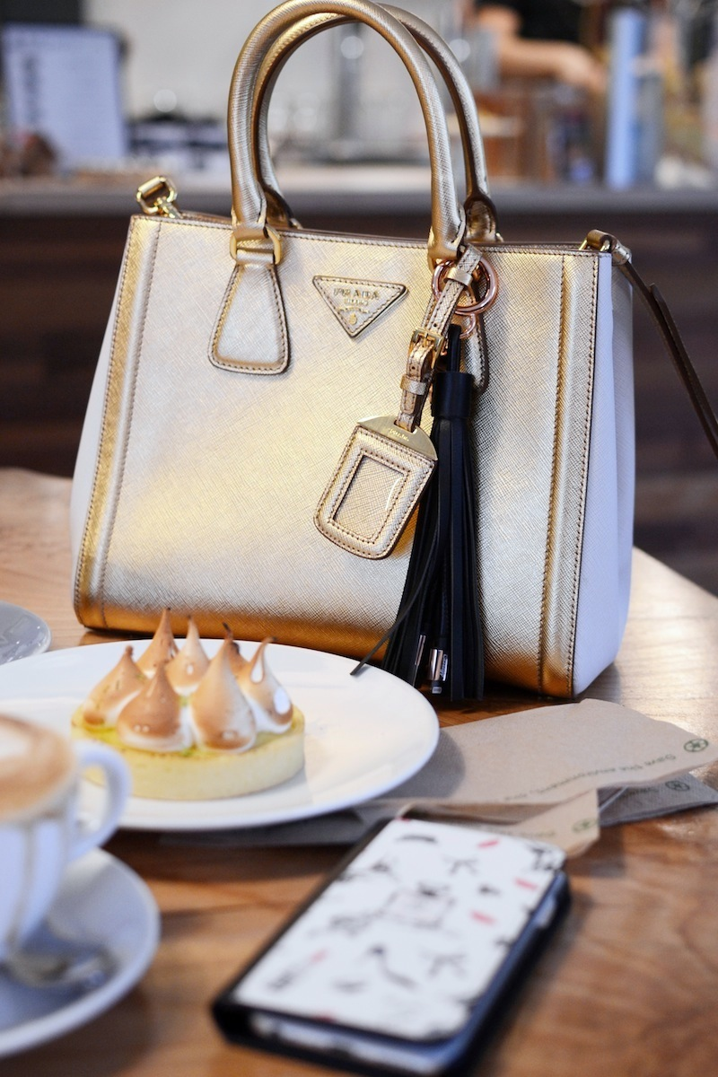 Prada saffiano lux tote gold casetify tassel charging cable