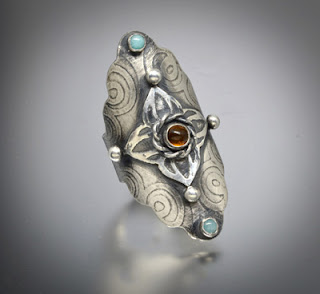 http://brackendesigns.com/product/medieval-style-large-sterling-silver-boho-saddle-ring-featuring-amber-and-amazonite