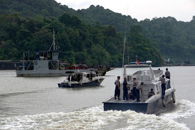 Police boats are patrolling the strait between the mainland and Nusakam Bangan Island, Indonesia.