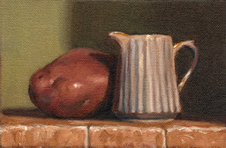 Oil painting of a small white porcelain fluted Jug beside a Désirée potato.