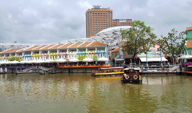 Clarke Quay- singapore river, boats and colorful houses