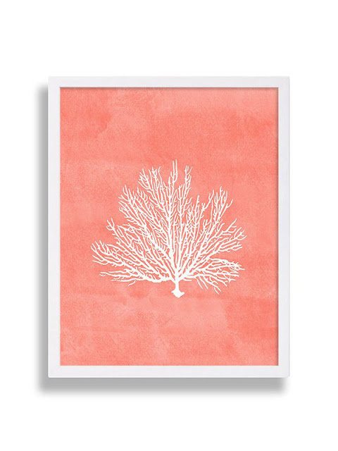 Hang paintings or posters with a living coral hue