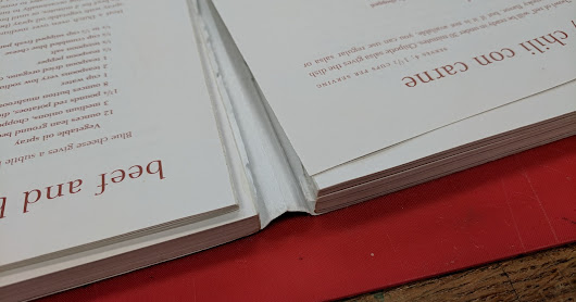 Converting an adhesive bound paperback to a sewn hardcover