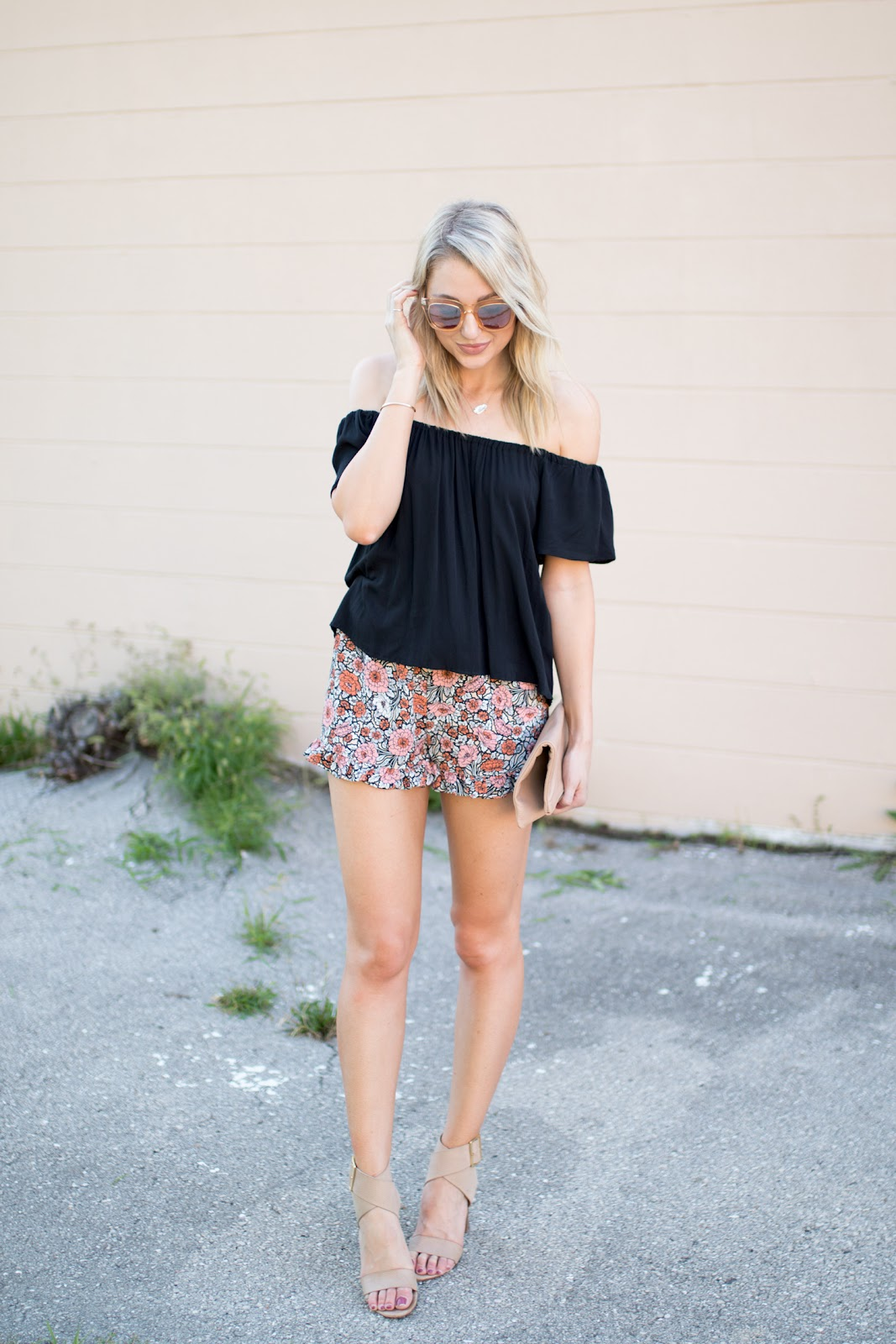 Black off-the-shoulder top with floral shorts