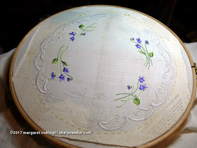 Society Silk Violets: embroidered silk buttonhole edge nearly complete on antique stamped linen
